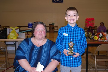 Heather Hempstock (left), Jacob Dunham (right), 1st place Grades 1 - 2, How to make a lemon battery