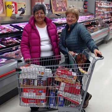 Louisa Alexie and Marj Lubbers purchase groceries for the local food bank in Peace River